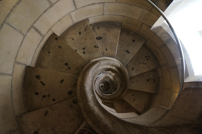 A view looking down the tower stairs inside La Sagrada Família. The architect, Antonio Gaudi, designed them to look like the shell of a nautilus.