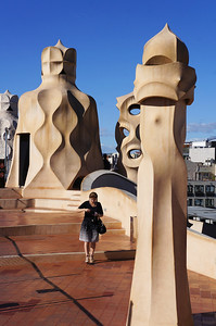 On the roof of Casa Mila (aka La Pedrera). Gaudi's fantastical sculpturing over chimney stacks is one of the biggest tourist attractions in Barcelona.