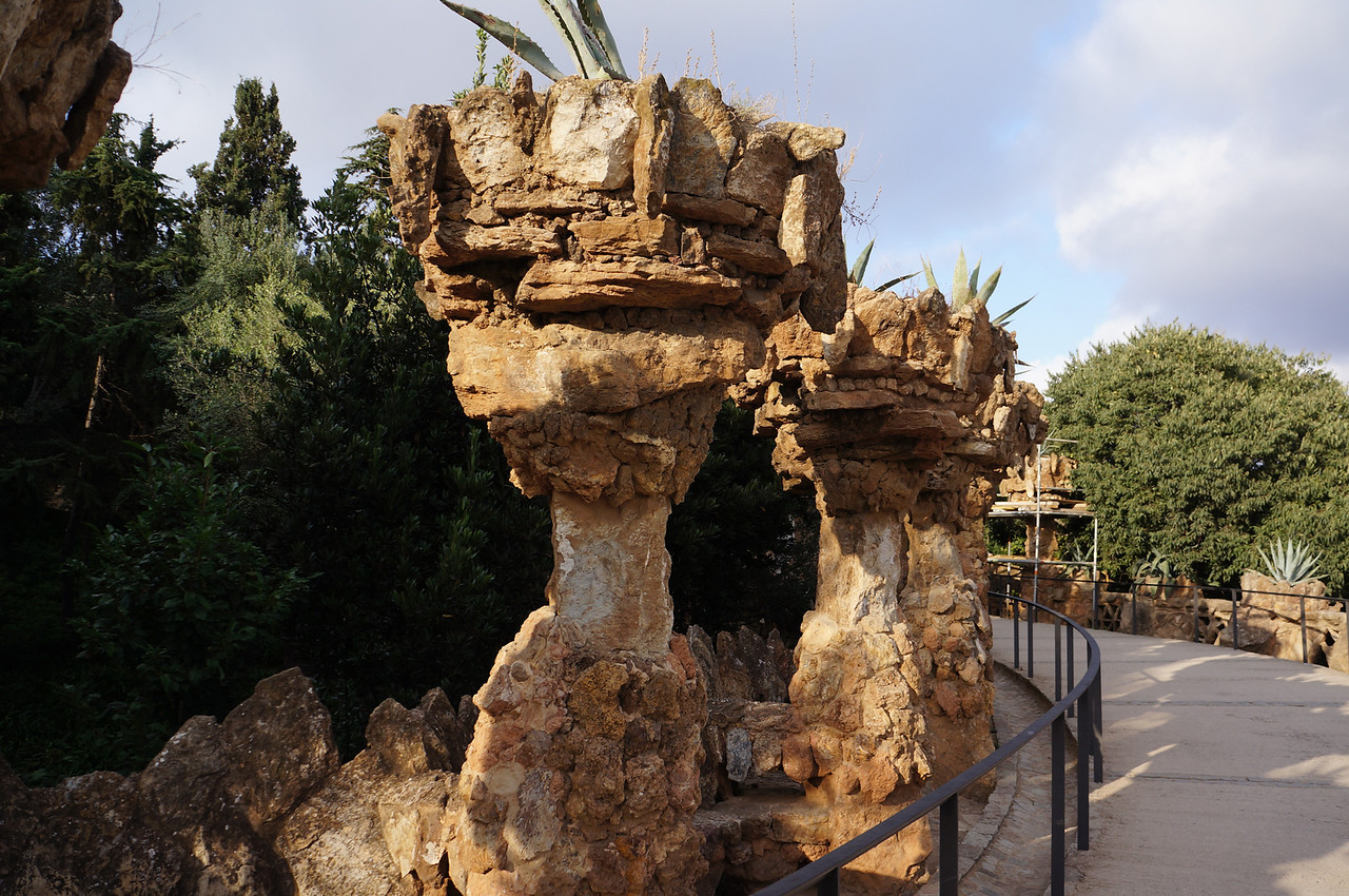 Paths wind in and around Parc Guell with amazing sculptured columns decorating the landscape.