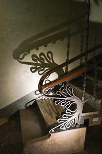 A staircase inside Palau Guell. Gaudi left nothing to chance and even designed intricacies into the railing.