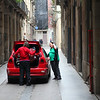 From the bumps and scratches on the car you just know that these people are not a member of the high society...<br /> I like this shot, because it shows the REAL people of Barcelona!!