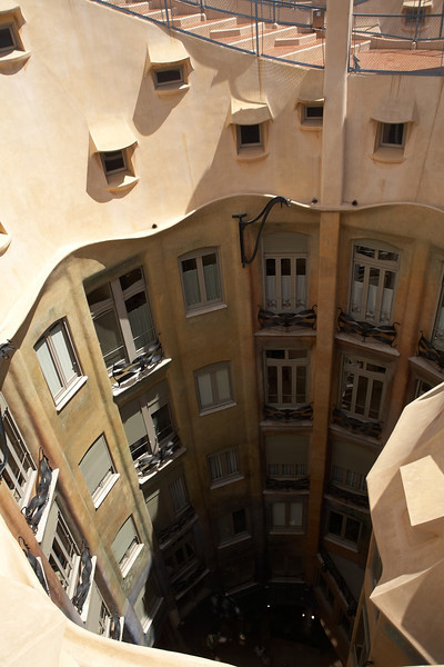 A look from above into one of Casa Mila's courtyards. Believe it or not, an entire level was lived in by a single family. That apartment is part of the tour.