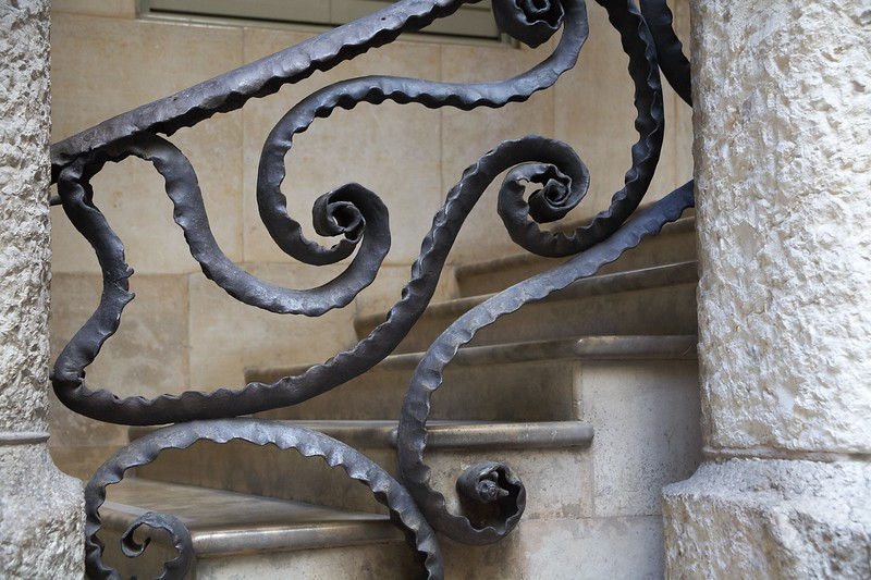 A fanciful railing for one set of stairs.