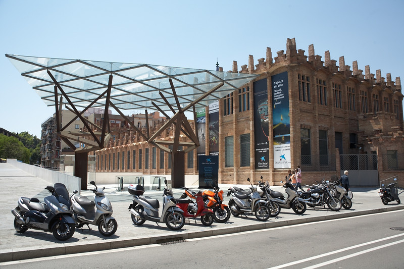 Caixa Forum along with one of more popular forms of transportation. This building shows some of the Caixa Bank's art collection.