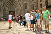 Huge line of tourists who are waiting to enter the Barcelona cathedral.