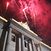 The opening ceremonies conclude with fireworks over the City Hall building.