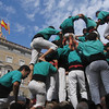 The castellers grasp each other's ankles, dig their feet into the crooks of knees, and otherwise shimmy their ways up their teammates' bodies to stand atop their shoulders.