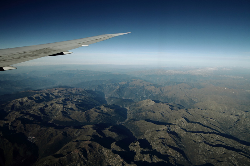 Flying over France, closing in on Barcelona with the Pyrinees Mountains in the distance - with snow on the tops.