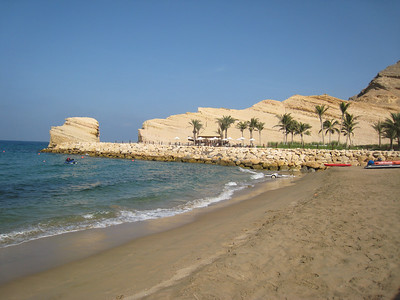 The beach at Barr al Jissah looking towards the headland.