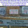a collection of water  crisis signs