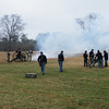 Smoke hangs over the field after the cannons are fired.