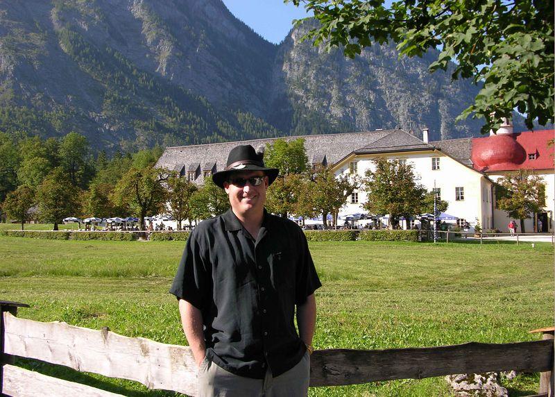 Brett wearing a traditional Bavarian hat (Loden Huete) next to St. Bartholomew.