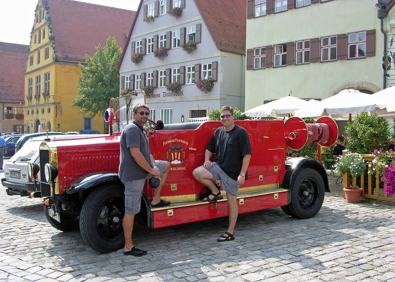 Hermann and Brett with a classic Mercedes firetruck.