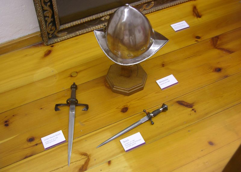 View of a medieval helmut, left and right handed daggers.