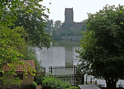 View of the Rothenburger Tor (gate) across the Gaulweiher pond.