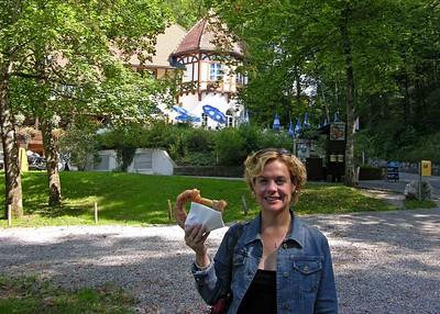 "Jodi having a ""sweet"" pretzel on the walk down from Neuschwanstein."