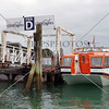Cruise ship tender boat is docked at the pier of Paihia Village wharf in Bay of Islands, New Zealand.