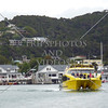 Catamaran boat departs Paihia Village wharf in Bay of Islands, New Zealand.
