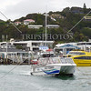 Fast Ferry boat departs Paihia Village wharf in Bay of Islands, New Zealand.