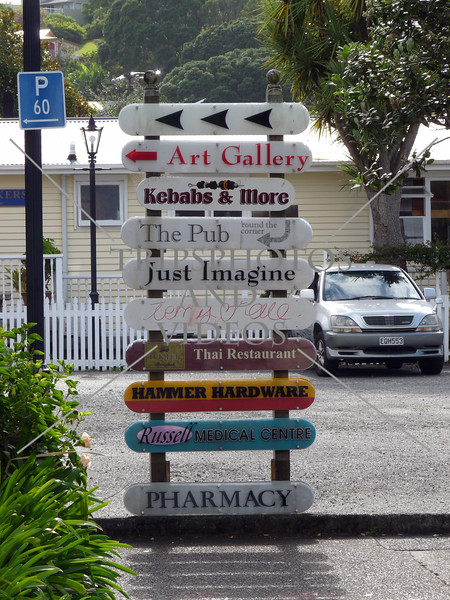Directional signs on Russell island in Bay of Islands, New Zealand.