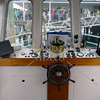 Steering wheel and instruments of a Ferry boat.