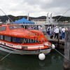 Cruise ship tender boat disembarks passengers at Waitangi wharf in Bay of Islands, New Zealand.