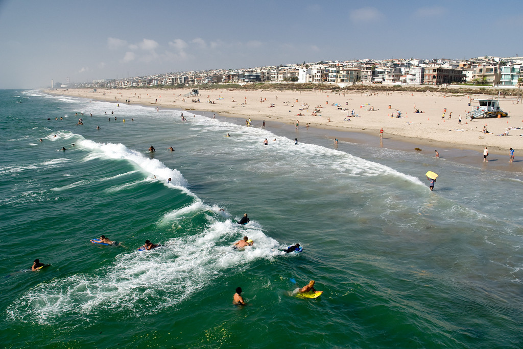 Riding the waves at Manhattan Beach.