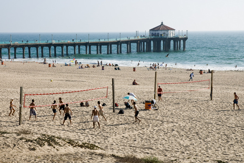 Beach volleyball at the pier.