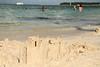 Sand castle on the beach.  Building sand castles on the beach seemed to be a popular activity.