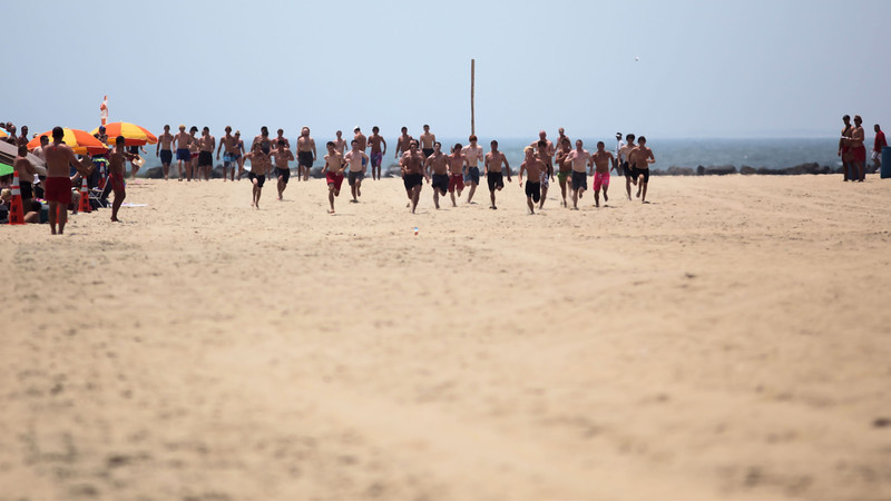 With three hundred yards of hot sand to cross, the first heat of competitors take off.