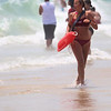 On the beach, one of the working lifeguards returns from a quick rescue.