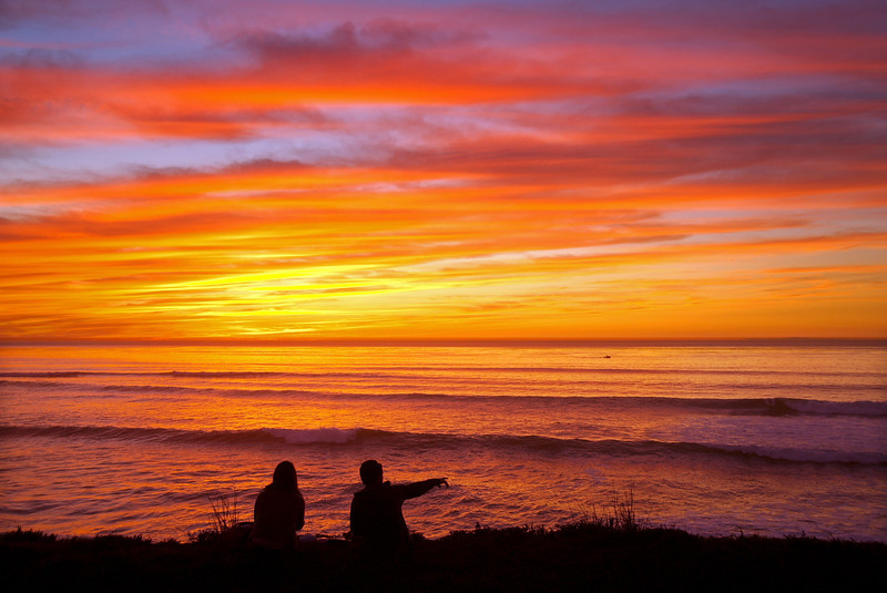 A couple enjoys a fantastic sunset at Sunset Cliffs, in San Diego, California.