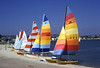 Colorful Hobie Cat sailboats on the beach at Mission Bay, in San Diego, California.