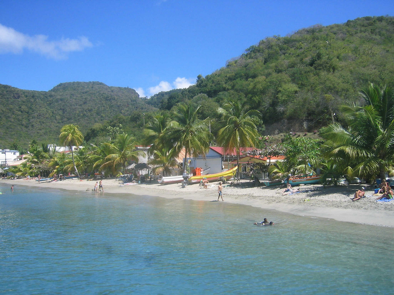 There are restaurants and rentals along the beach in Grande Anse.