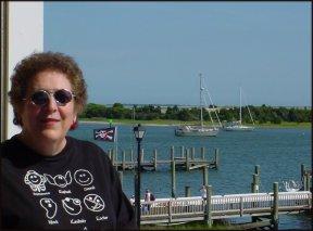Susan on room deck overlooking Beaufort harbor
