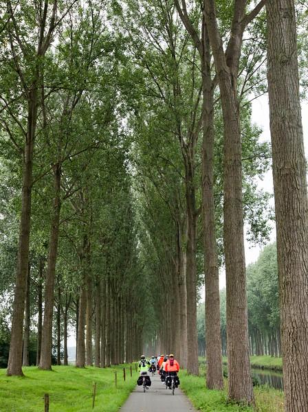 Flanders, Belgium - Scenic canal cyclepath towards Brugge.