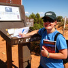 "At the ""Spooky Slot Canyon"" trailhead registering my name in the log book in case I go missing.  My favorite book travels with me. Grand Staircase National Monument, UT.  10/1/08"