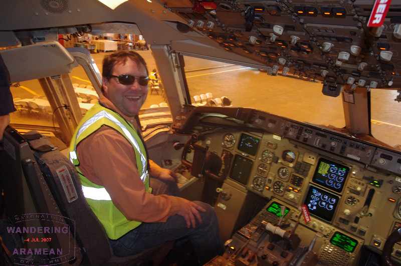 Nathan at the controls in the cockpit