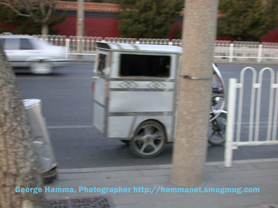 An enclosed motorbike rickshaw.
