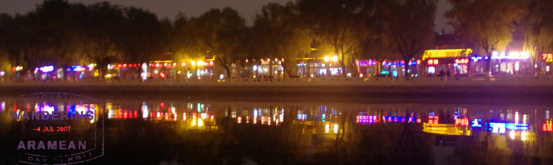 The glow of the bars along the waterfront in Houhai, Beijing