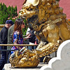 Female lion with cub in front of the Palace of Tranquil Longevity