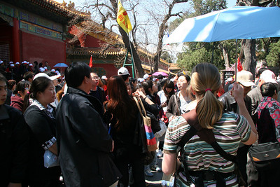 I mentioned crowds at the Forbidden City, right?  Gretchen tries to ford the center avenue stream as we go from one side of the complex to the other.