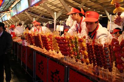 Sticks of sugar encased fruit at the night market