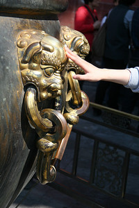 All around Forbidden City are massive iron cauldrons, which served as fire extinguishers back in the day.  They have ornate handles on the sides - all items in FC must have ornate something on the sides, and I can't imagine anyone, or even a group of anyones able to lift one of these by the handles.  Apparently it's good luck to touch the dragon handles though, because they're well polished.