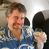 Fauster enjoying a pre-flight glass of champagne.