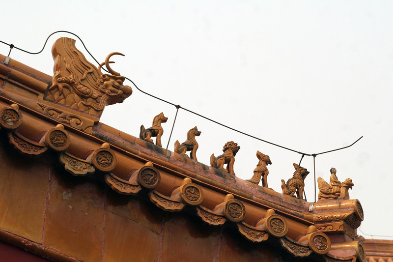 These are on the top of each building in the Forbidden City. There's always an odd number for good luck. The more characters, the more important the building (or the people living in it). The most characters on a building was 11.