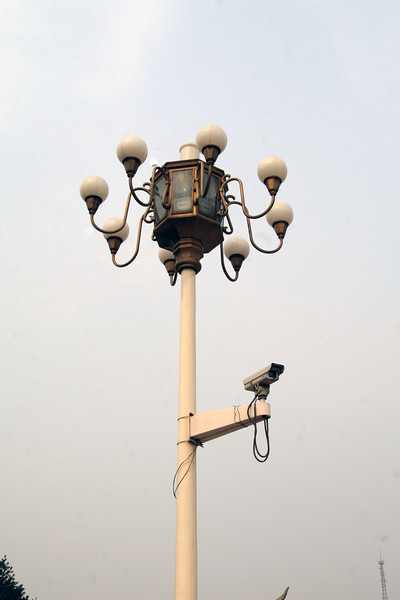 This lightpost is at Tiananmen Square. Note the video camera and the speakers inside the brass enclosure. There are speakers all over Beijing, which is kinda creepy, if you ask me.