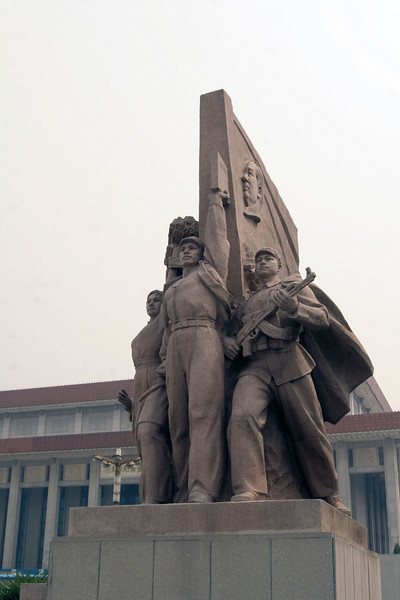 "According to Lee, a Beijing local, these statues on either side of Mao's tomb are of the ""Leaders"" - farmers and soldiers."