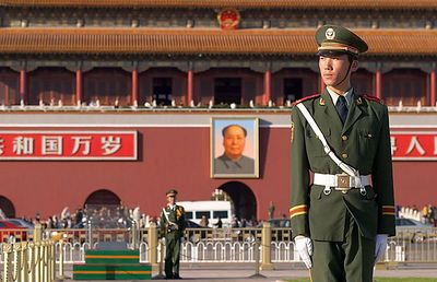 Guard at Tiananmen Square (the Tiananmen Gate is across the street in the background).