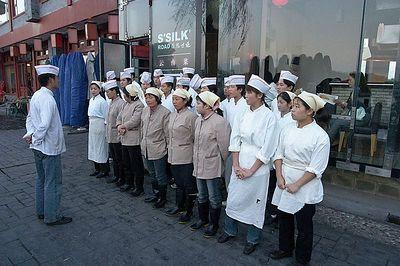 Restaurant staff meeting outdoors.